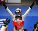 Jenson Button celebrates after his win