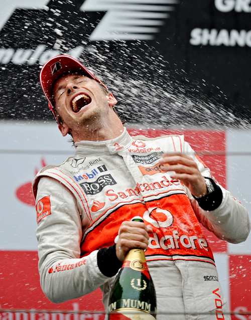 Jenson Button takes a hit from the champagne