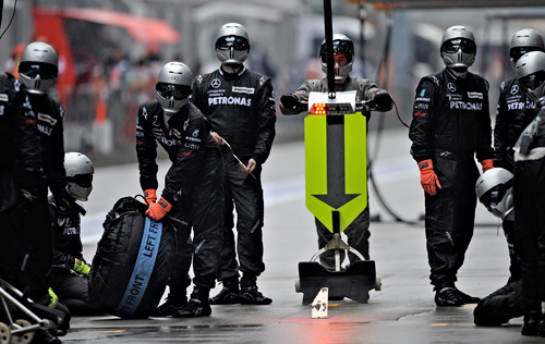 The Mercedes pit crew wait for Nico Rosberg