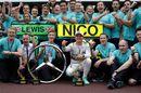 Nico Rosberg celebrates his win with Mercedes members