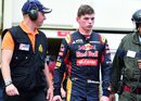 Max Verstappen walks to the pit after retirement