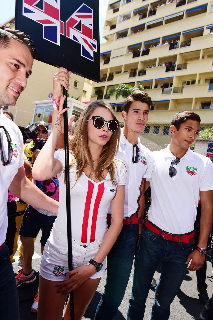 Cara Delevingne holds Lewis Hamilton's grid board