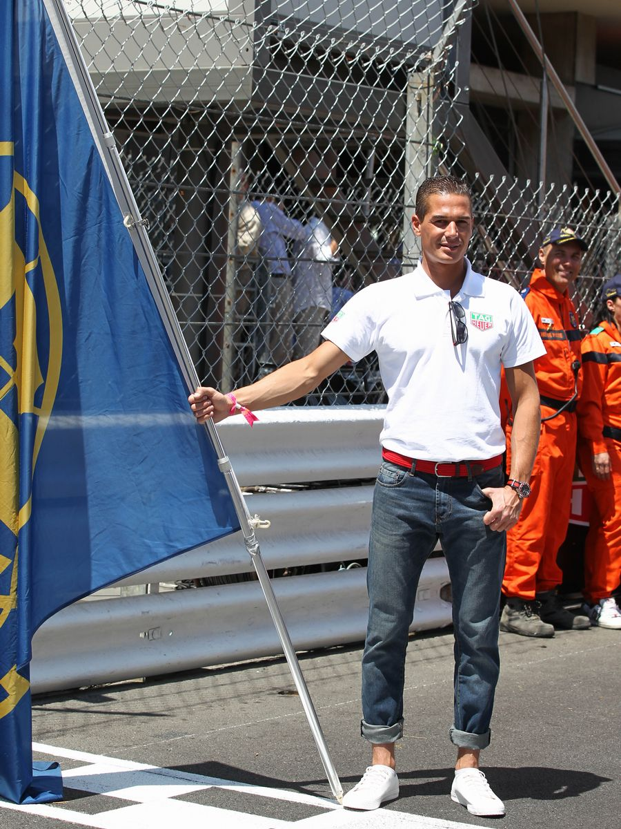 A grid boy poses ahead of the race