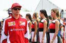 Kimi Raikkonen heads off to the drivers parade