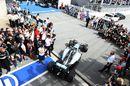 Race winner Lewis Hamilton parks his car in parc ferme