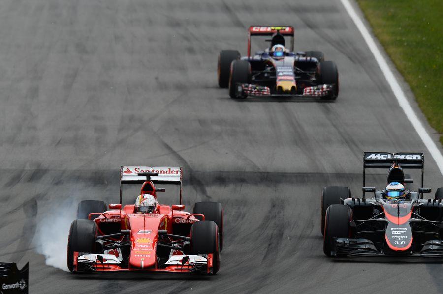 Sebastian Vettel locks up while passing Fernando Alonso