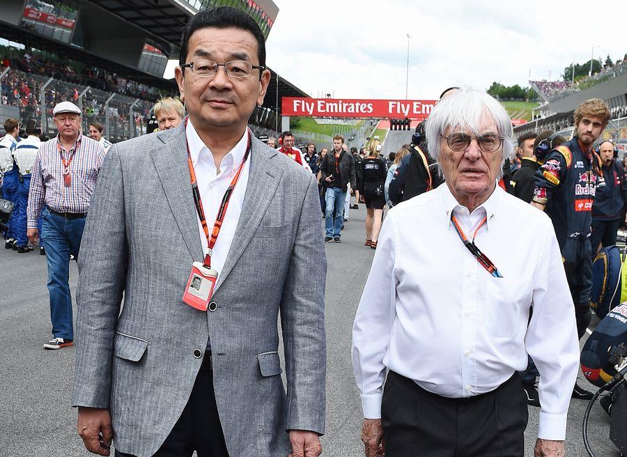 Takahiro Hachigo and Bernie Ecclestone walk down the grid