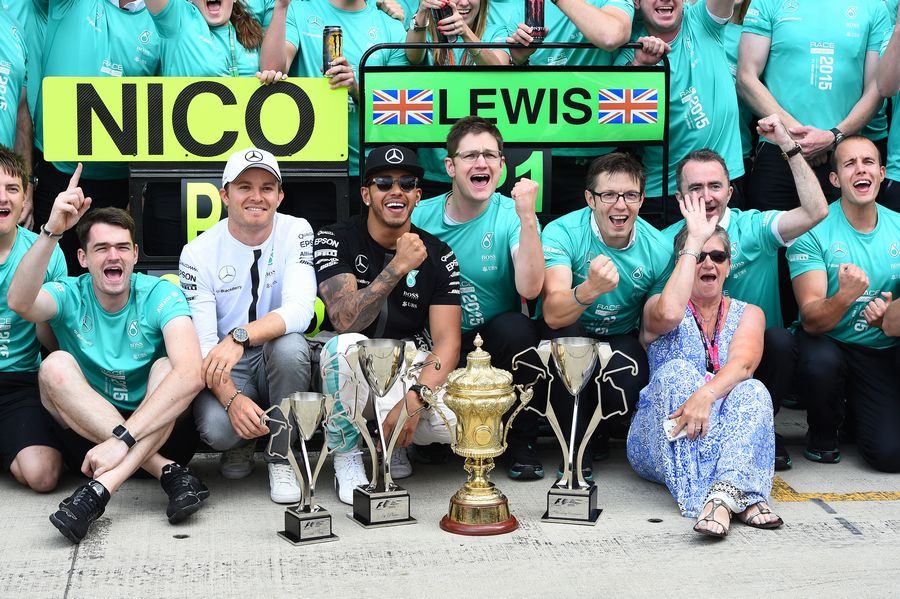 Lewis Hamilton celebrates his win with his Mother Carmen Lockhart and Mercedes