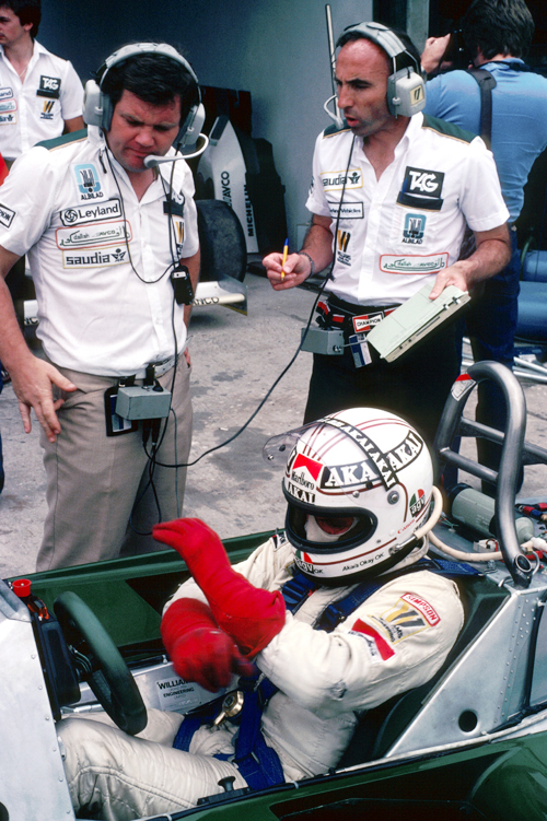 Alan Jones prepares himself in the Williams FW07C