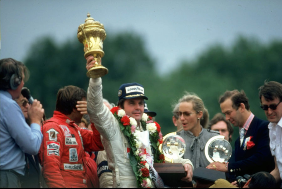 Alan Jones celebrates victory at Silverstone