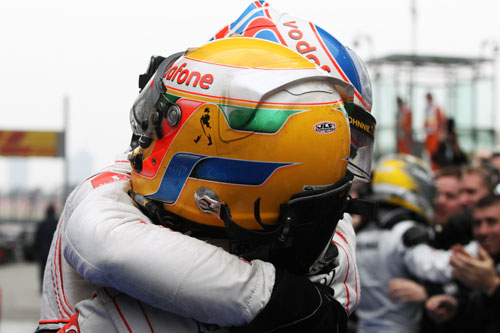 Lewis Hamilton congratulates Jenson Button on his win