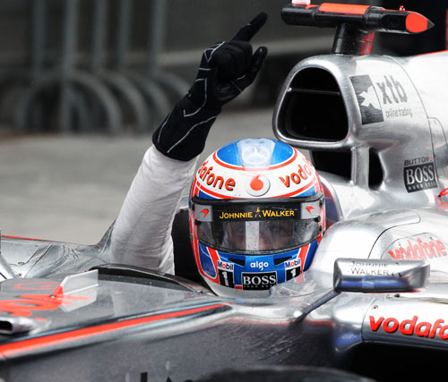 Jenson Button shows his emotions after winning the race