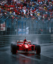 Michael Schumacher picks a line through the spray on his way to winning the race