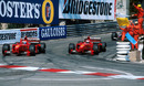 Eddie Irvine and Michael Schumacher celebrate a Ferrari one-two