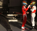 Fernando Alonso and Lewis Hamilton chat after the race