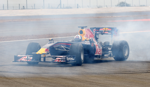 David Coulthard wheelspins out on the track in a Red Bull Formula One car during the launch of the new circuit at Silverstone