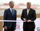 Prince Andrew opens the new Silverstone circuit watched by BRDC president Damon Hill