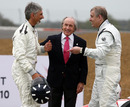 Prince Andrew shares a joke with BRDC president Damon Hill as Sir Jackie Stewart looks on