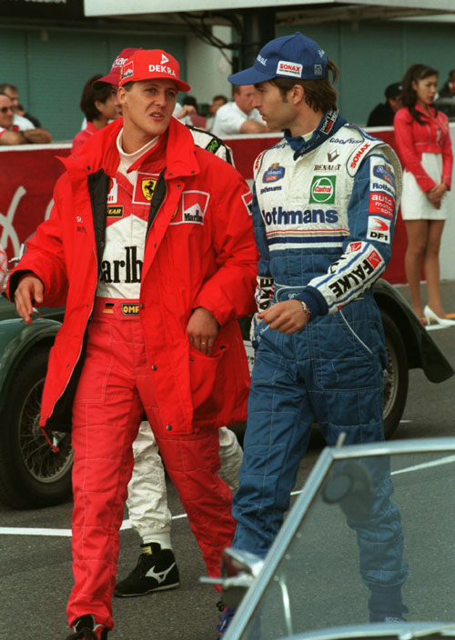 Michael Schumacher  chats to Heinz-Harald Frentzen