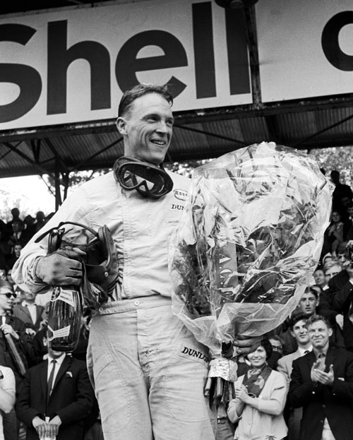 Dan Gurney celebrates his victory, the first for the Brabham marque