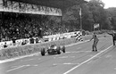 Dan Gurney takes the chequered flag for Brabham's first victory