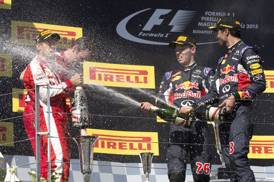 Top 3 drivers enjoy their champagne celebrate on the podium