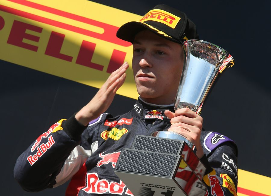 Daniil Kyvat celebrates with the trophy on the podium