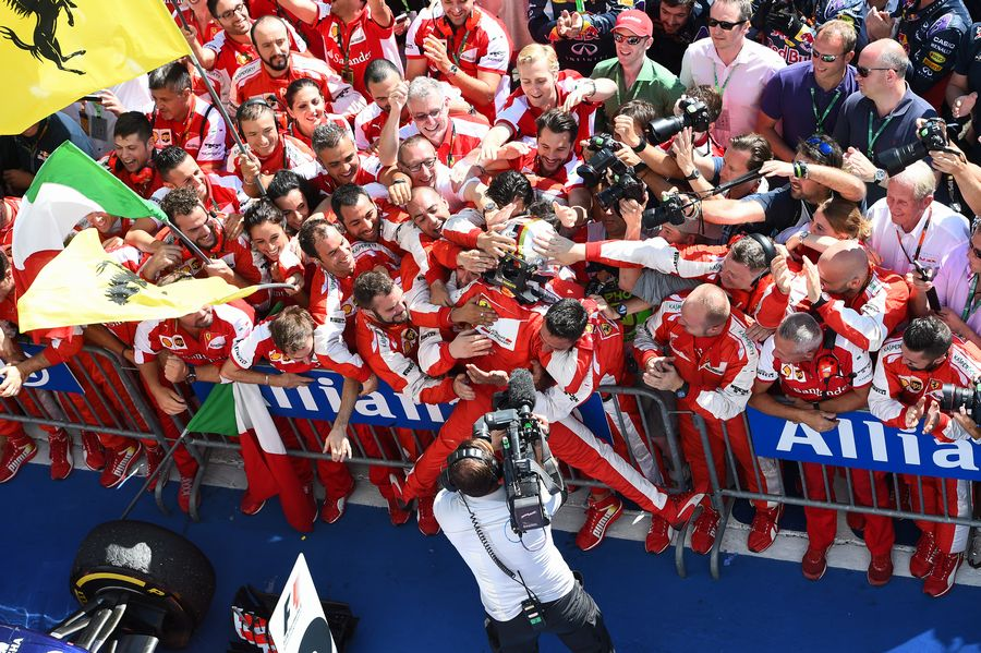 Sebastian Vettel celebrates his win in parc ferme with the team
