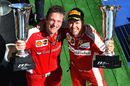 Sebastian Vettel and James Allison celebrate on the podium with the trophies