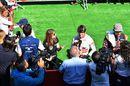 Romain Grosjean talks with media