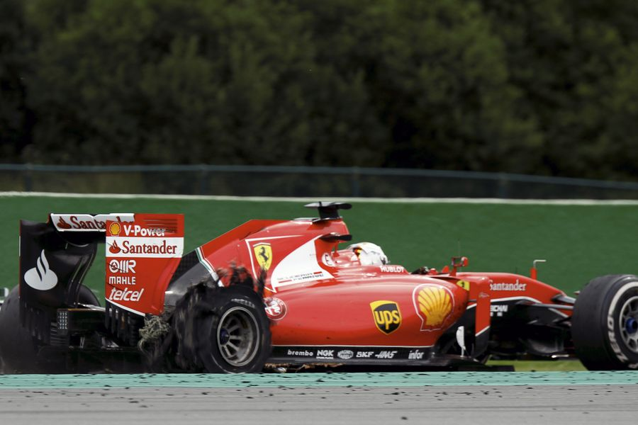 Sebastian Vettel limps back to the pits with a puncture