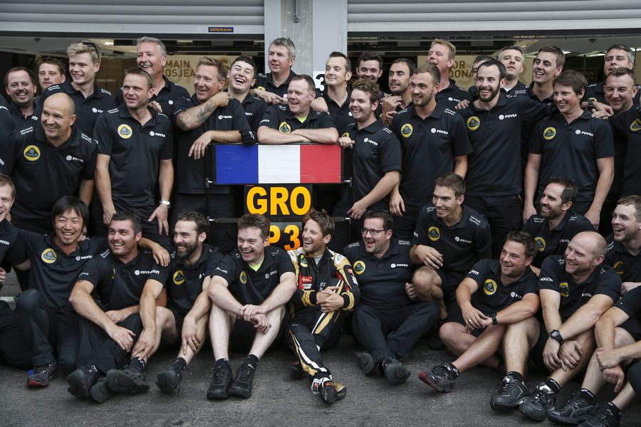 Romain Grosjean celebrates his third finish with Lotus