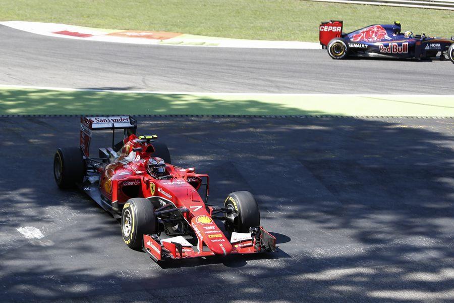 Kimi Raikkonen runs wide as he tries to pass Carlos Sainz