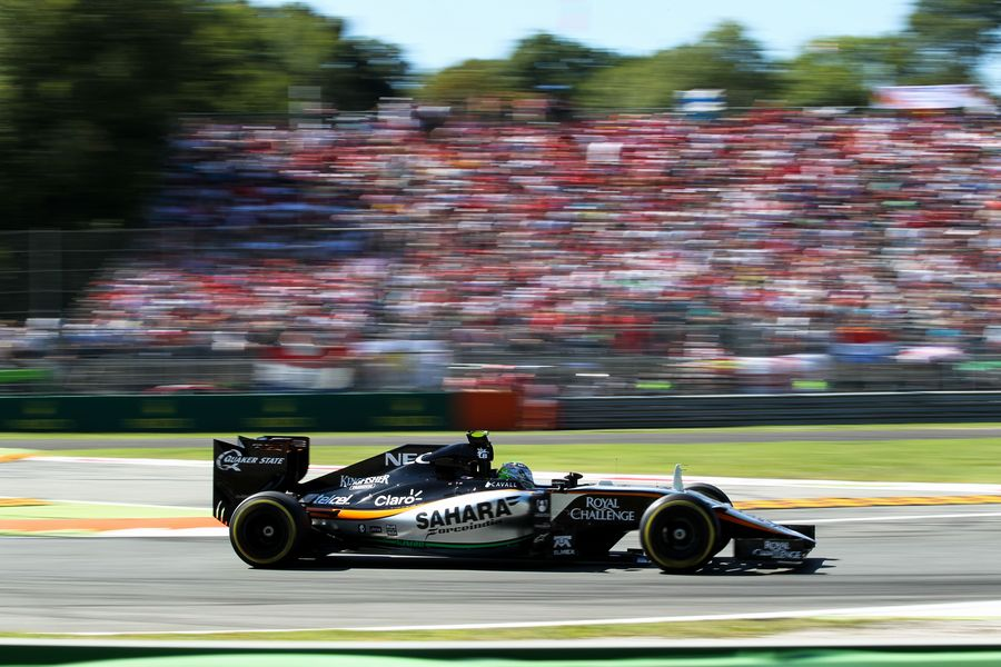 Sergio Perez works hard to keep pace