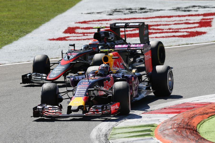 Daniil Kvyat battles a position with Jenson Button