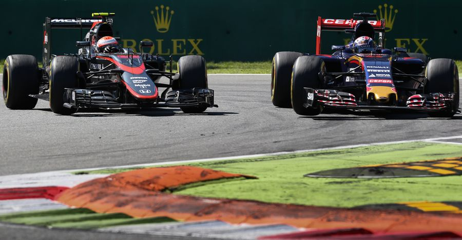 Jenson Button defends from Max Verstappen