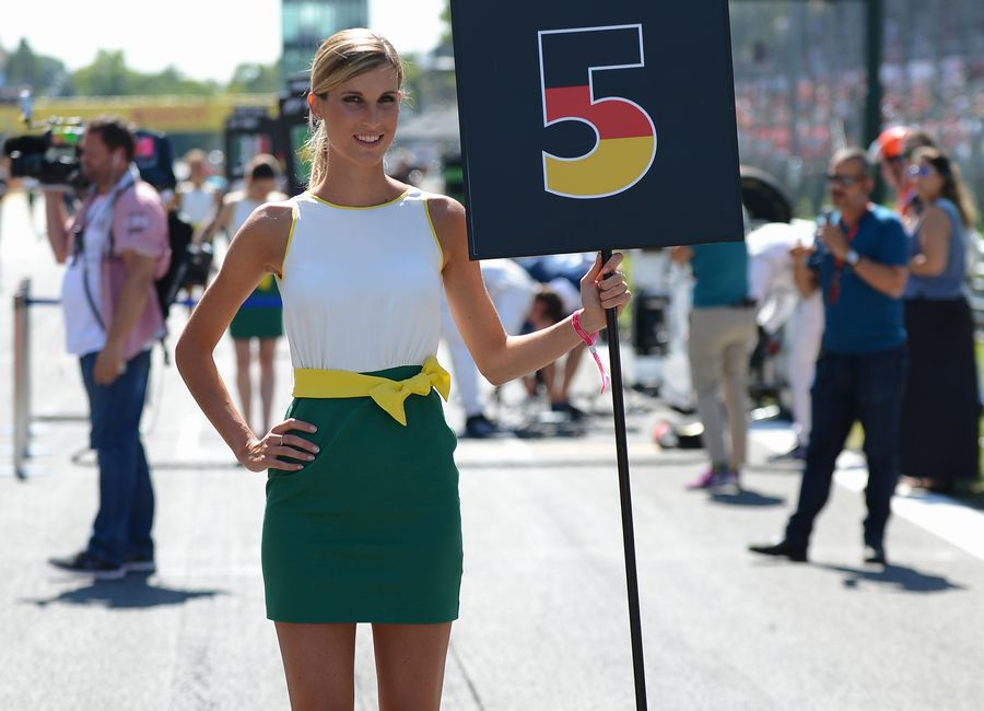 A grid girl poses ahead of the race