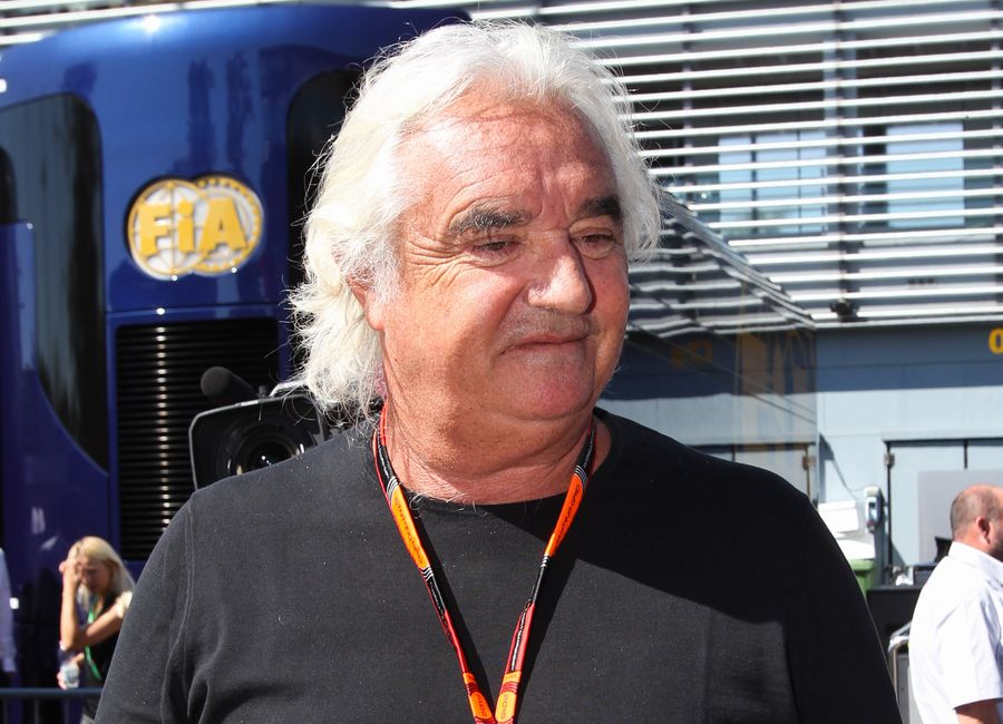 Flavio Briatore arrives the paddock