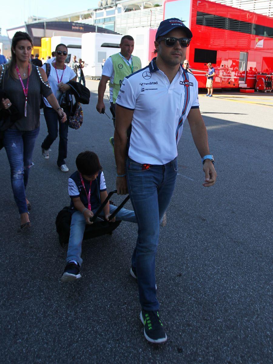 Felipe Massa arrives the paddock with his son Felipinho