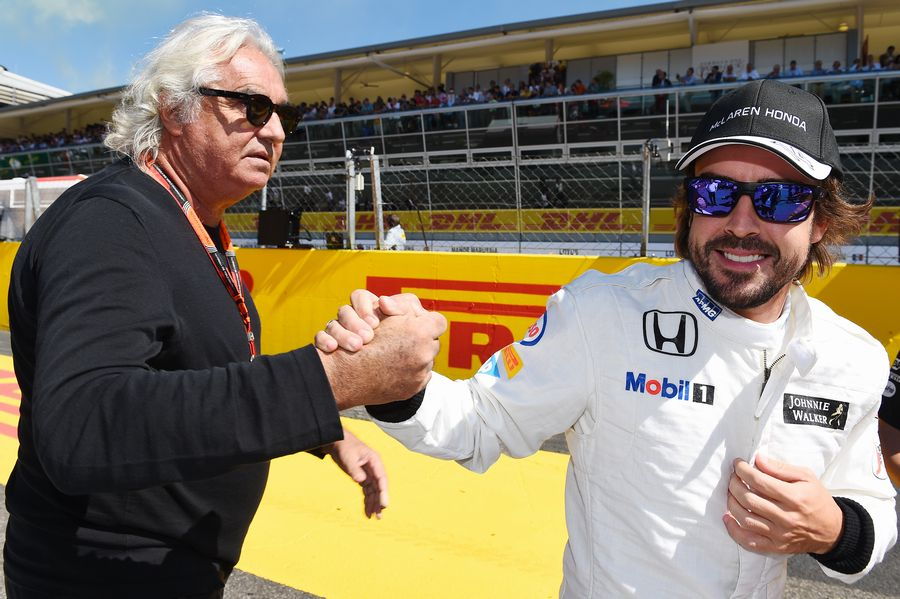 Fernando Alonso with Flavio Briatore on the grid
