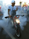 Lewis Hamilton performs a burnout on his MV Agusta Dragster RR motorcycle
