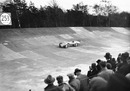 Sir Malcolm Campbell drives his famous Bluebird car around the track at Brooklands