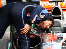 Mark Webber checks out McLaren's F-duct
