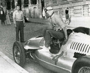 Tazio Nuvolari climbs out of his Auto Union after winning the Belgrade Grand Prix