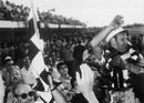Stirling Moss celebrates victory in the Argentine Grand Prix