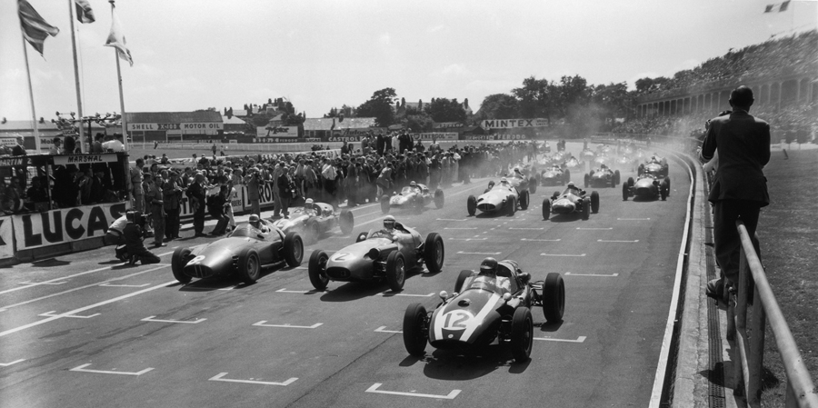 Jack Brabham (No. 12) leads away Roy Salvadori (No. 2) and Harry Schell (No. 8) at the start of the British Grand Prix