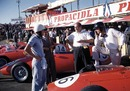 Phil Hill, Luigi Bazzi, Carlo Chiti and Dan Gurney with the Ferraris in the pits during the Portuguese Grand Prix