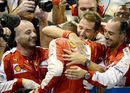 Sebastian Vettel celebrates his win with the team in parc ferme
