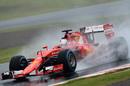 Sebastian Vettel on track with wet tyres