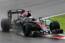 Fernando Alonso rides a kerb